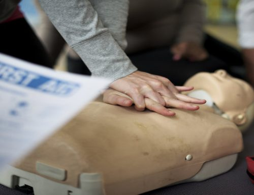 How do I qualify as a First Aid Trainer?